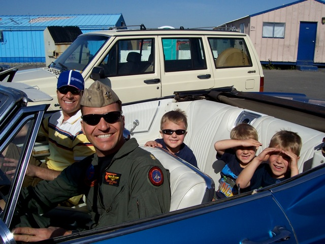 Vincent taking his brother, nephews, and son out for a cruise in the Impala.