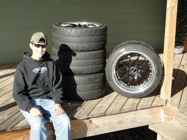 "Sam and a set of HUGE 18"" Forgeline wheels, courtesy a ""deal he couldn't refuse"" from Randy Johnson at D&Z Customs."