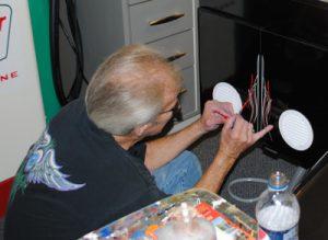 Ron Myers at work pinstriping